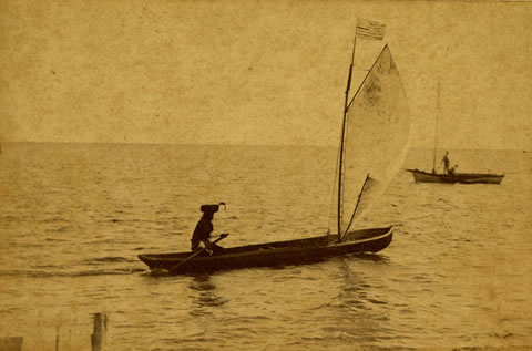 Seminole canoe with sail on Biscayne Bay
